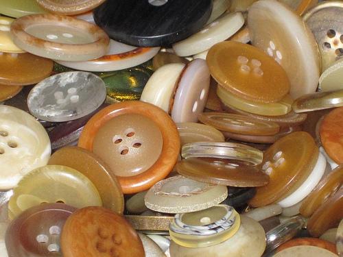 six million buttons closeup